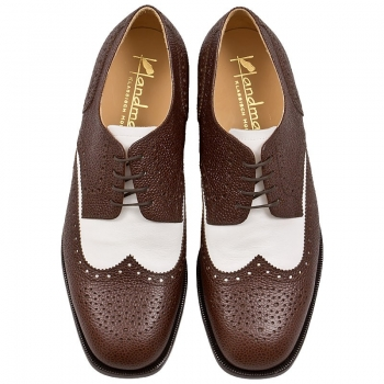 Brown and white shoes made by Handmacher